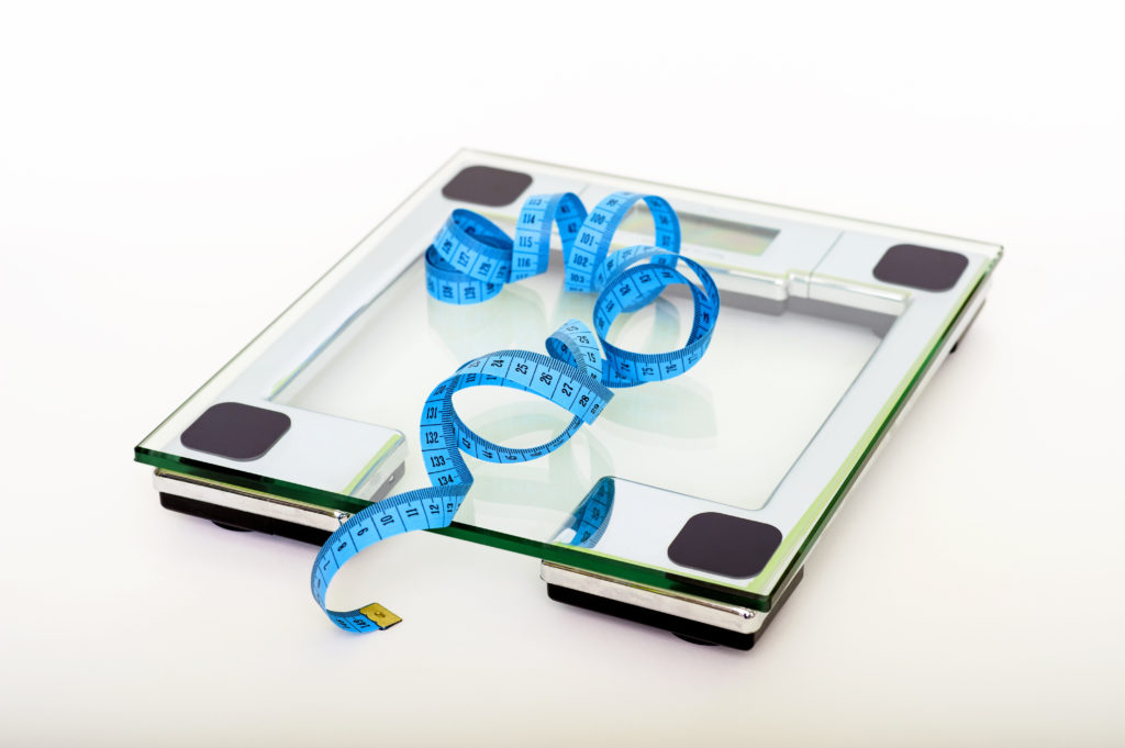 Canva - Blue Tape Measuring on Clear Glass Square Weighing Scale