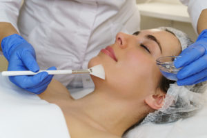 Cosmetologist applies moisturizing conductive gel before ultrasonic face cleaning procedure. Spa. Cleansing skin pores and deep moisturizing.