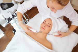 Woman on facial skincare procedure. Hardware cosmetology.